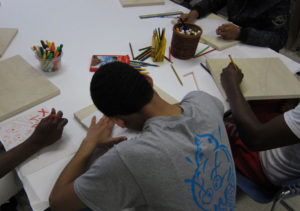 CASES participants work collaboratively to create an art installation.