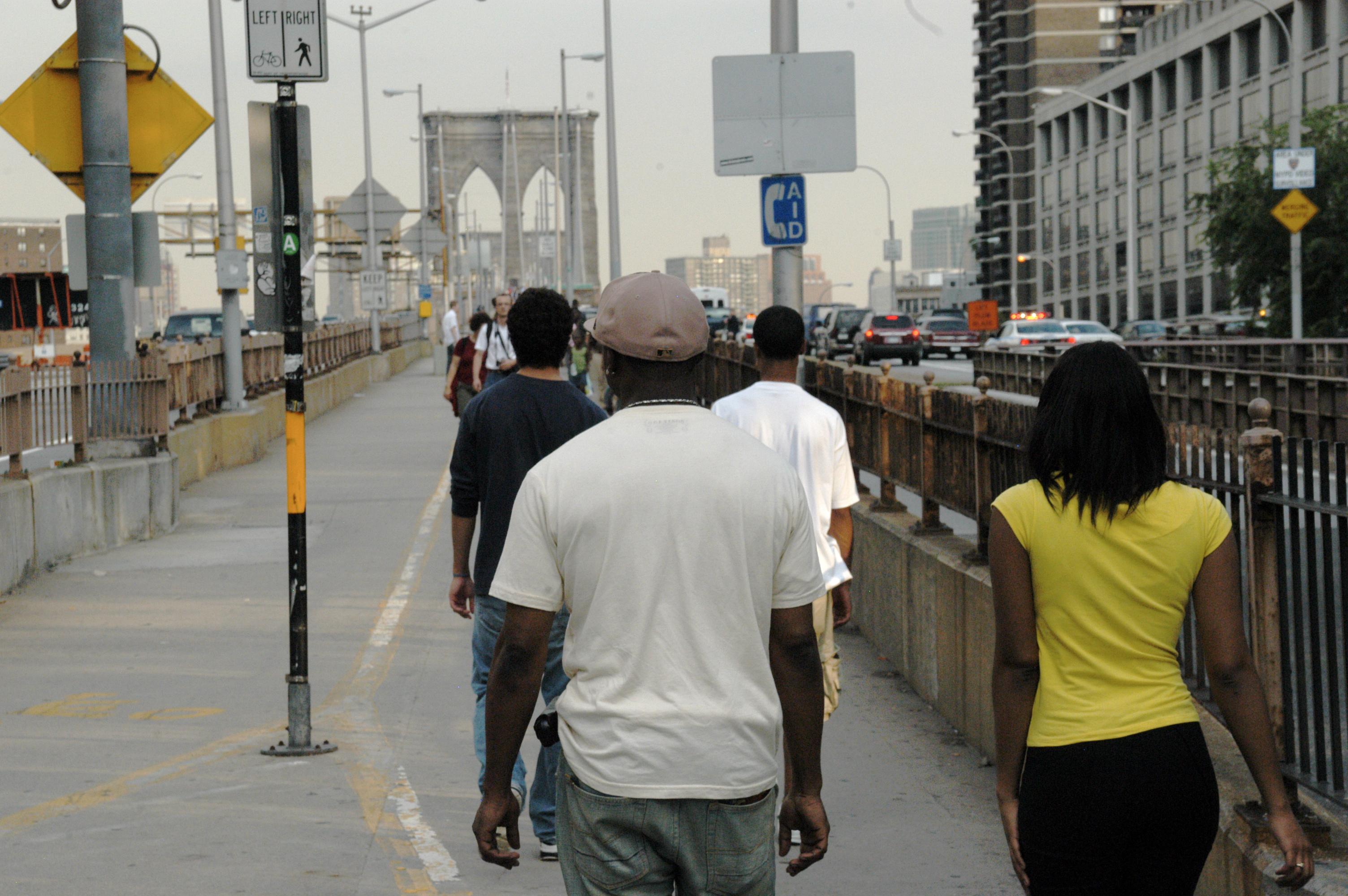 Participants cross the Brooklyn Bridge