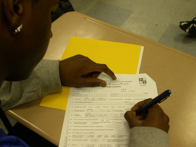 A CASES participant filling out a job application